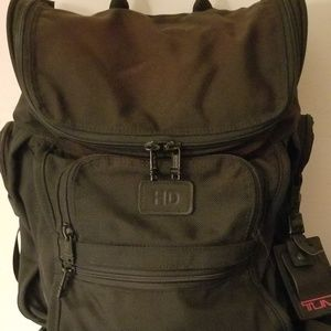 Tumi black back pack with red lines liner